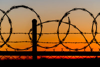 Razor Wire Fence Sunset